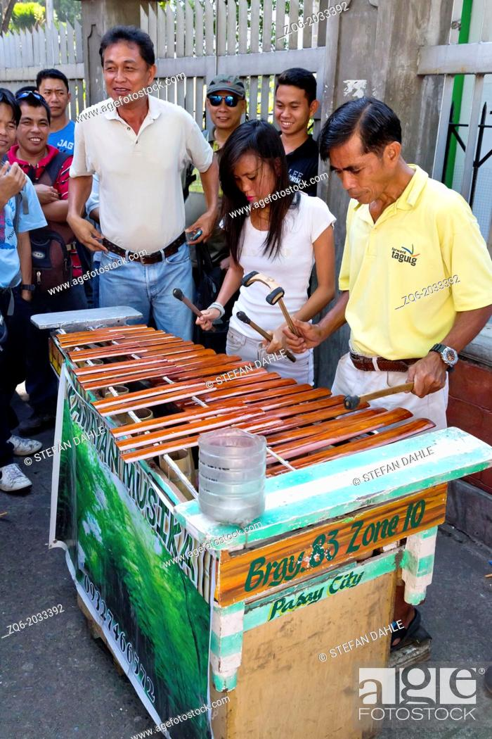 Stock Photo: Xylophone Players in the Streets of Malate in Metro Manila, Philippines.