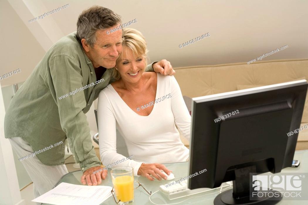 Stock Photo: Couple using computer.