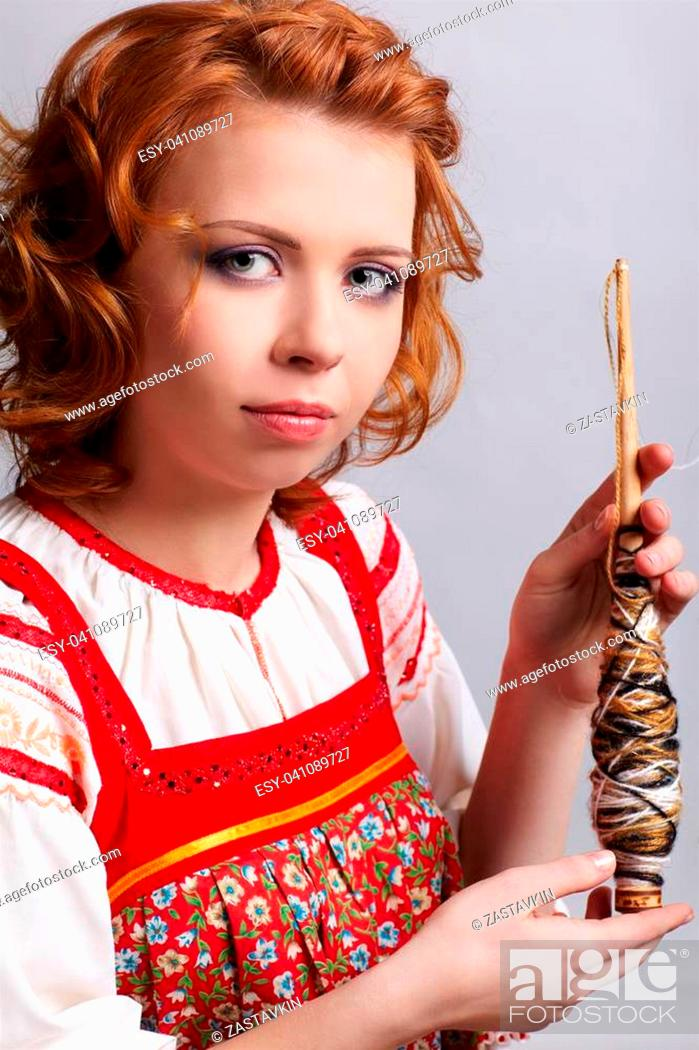 portrait of beautiful slavonic redhead girl in traditional ...