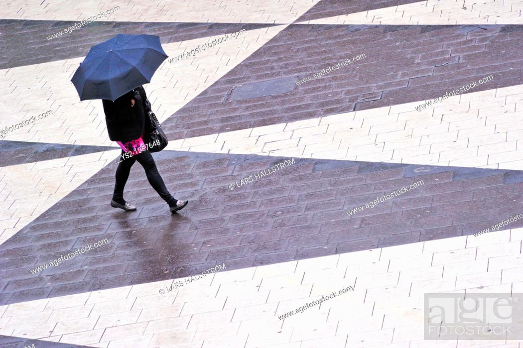 Stock Photo: Woman with umbrella at Sergels Torg in the center of Stockholm, Sweden, Europe.