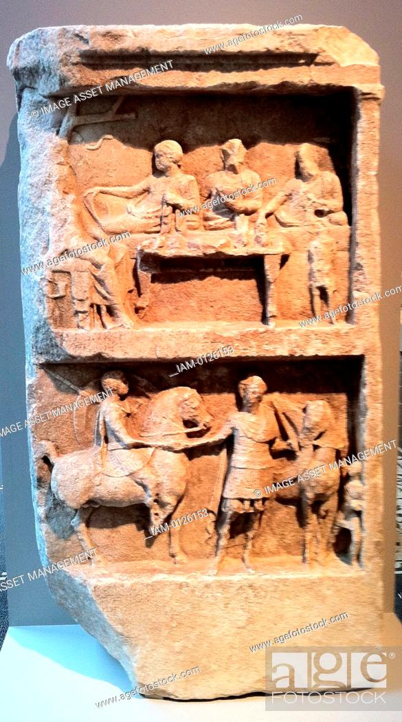 Stock Photo: Marble grave relief with a funerary banquet and departing warriors. Greek, Hellenistic 2nd century B.C.