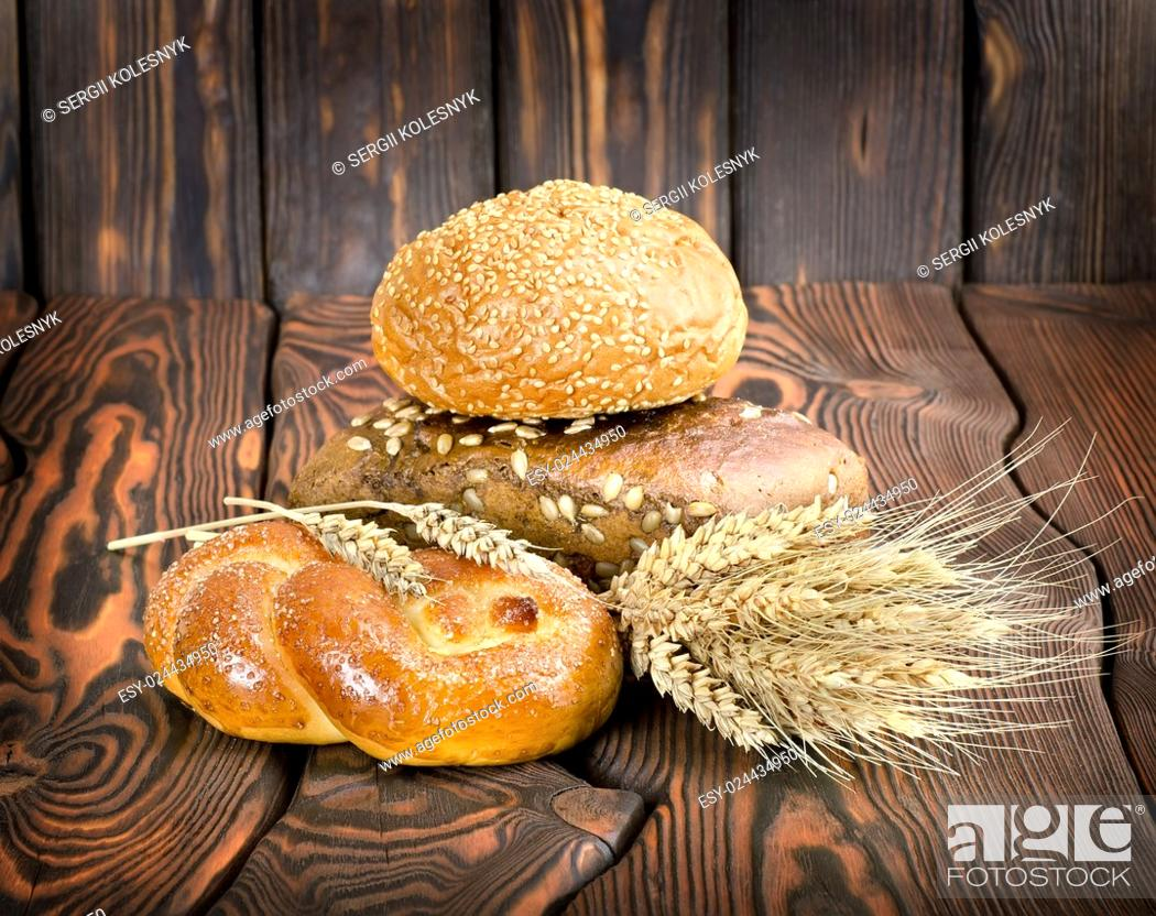 Stock Photo: Bakery products on a wooden brown background.