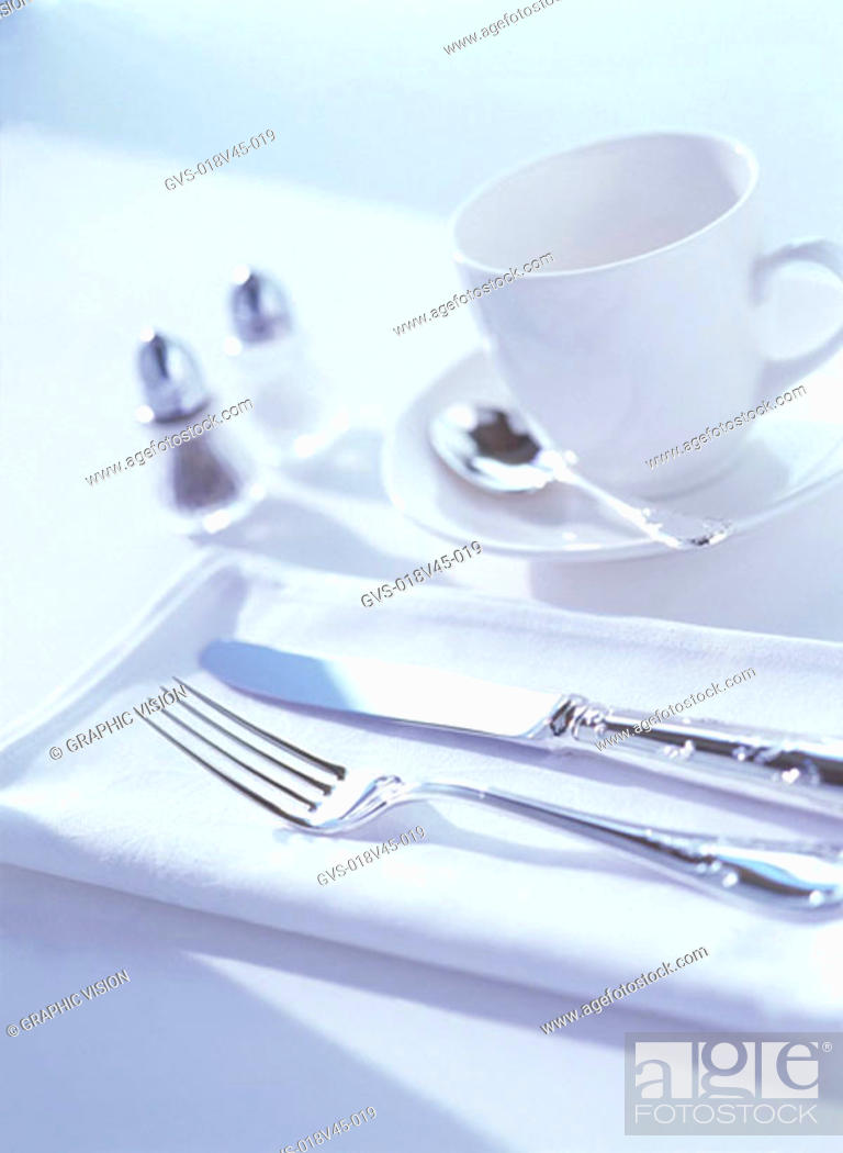 Stock Photo: Close Up of Knife Fork Tea Cup and Saucer.