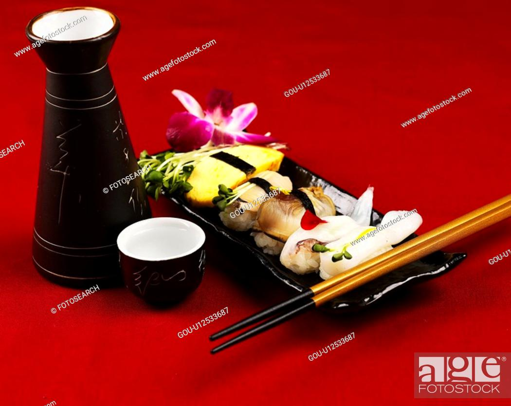 Stock Photo: sake bottle, plate, chopsticks, decoration, food styling, sake cup, sushi plate.