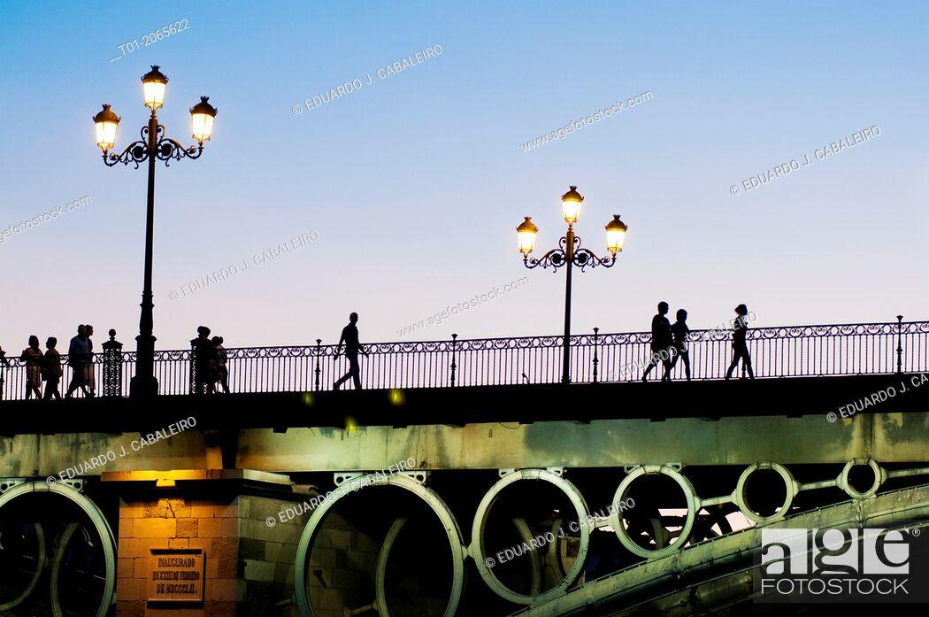Stock Photo: Triana bridge at night. Seville. Andalucia. Spain.