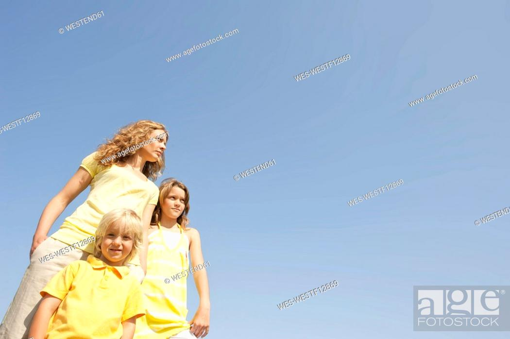 Stock Photo: Mother and children 4-5, 10-11, portrait.