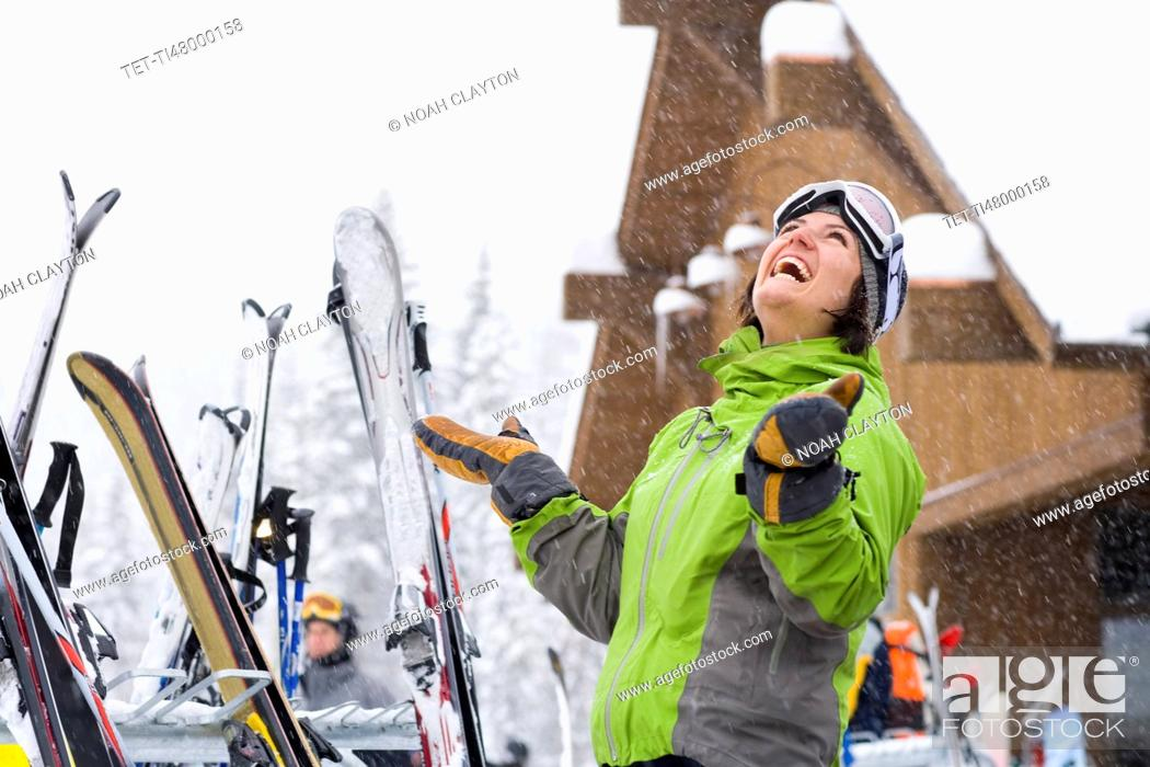 Stock Photo: Woman wearing ski googles with hands raised.