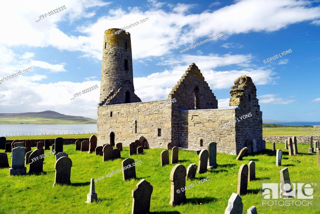 Stock Photo: Saint St. Magnus Church, Egilsay, Orkney Islands, Scotland. 12th C Viking Norse round bell-tower tower Christian Saint Magnus's chapel and graveyard.