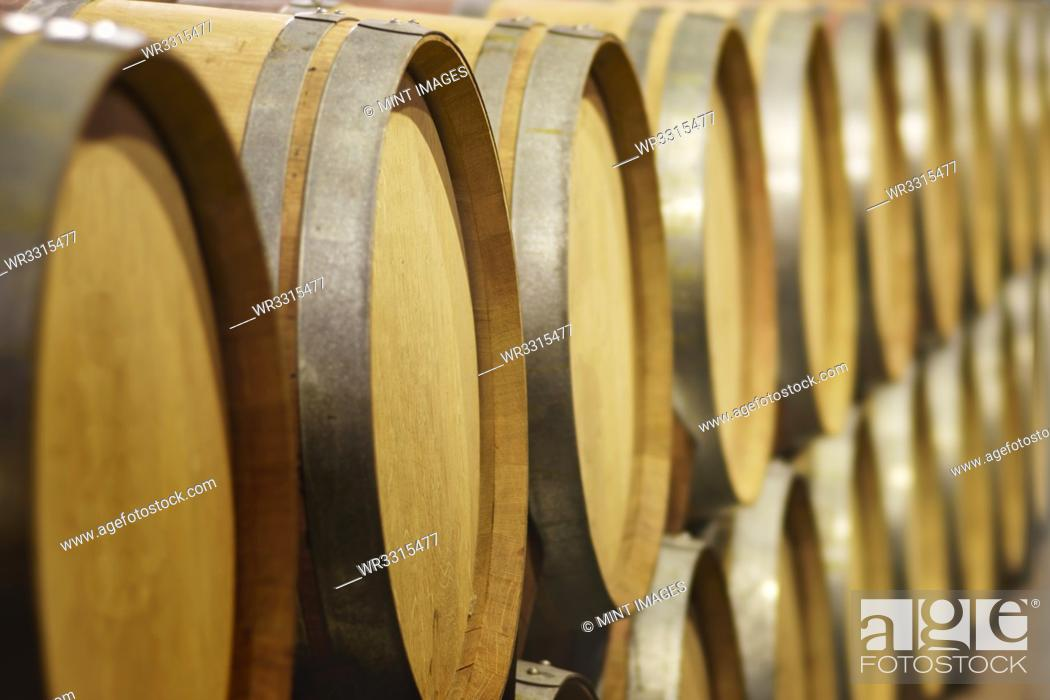 Stock Photo: Close up of wine barrels in cellar.