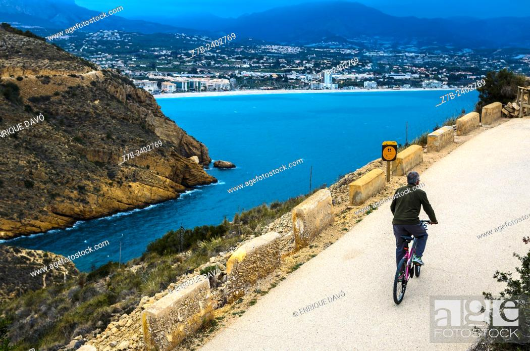 Stock Photo: View of a cyclist in Albir area, Alicante province, Spain.