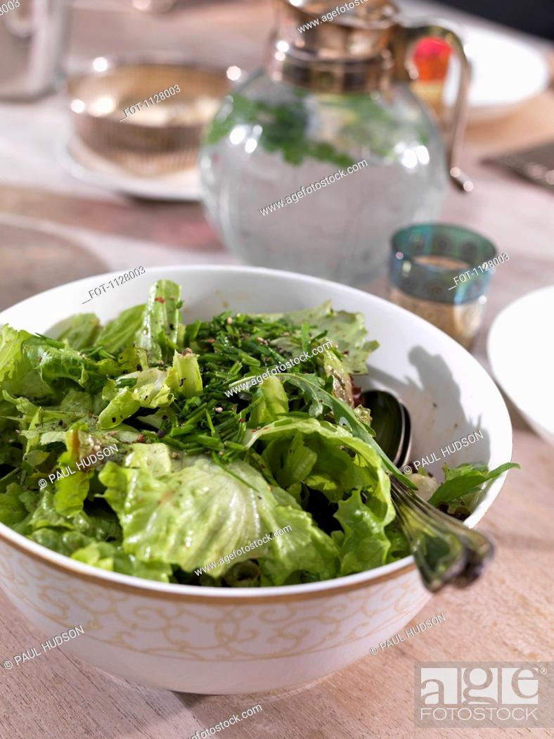 Stock Photo: Detail of a salad on a dining table.