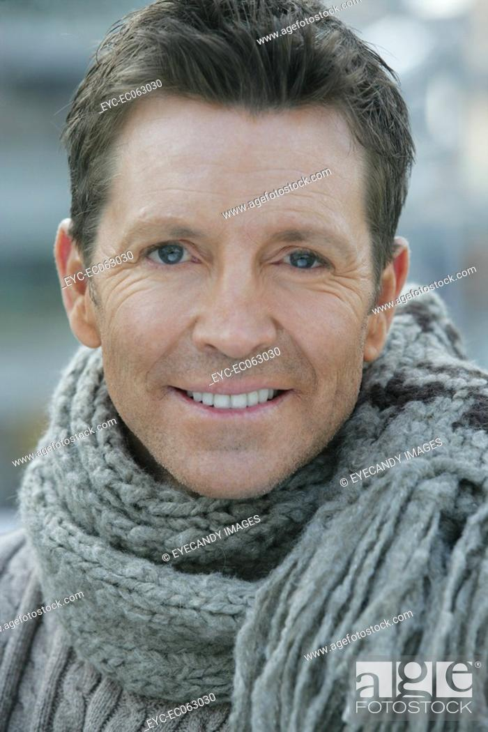 Stock Photo: Close-up of mature man wearing a scarf.