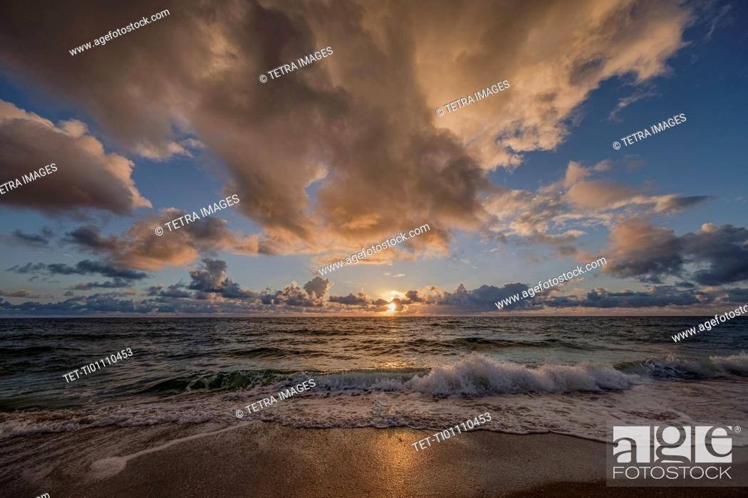Stock Photo: Dramatic clouds over sea.