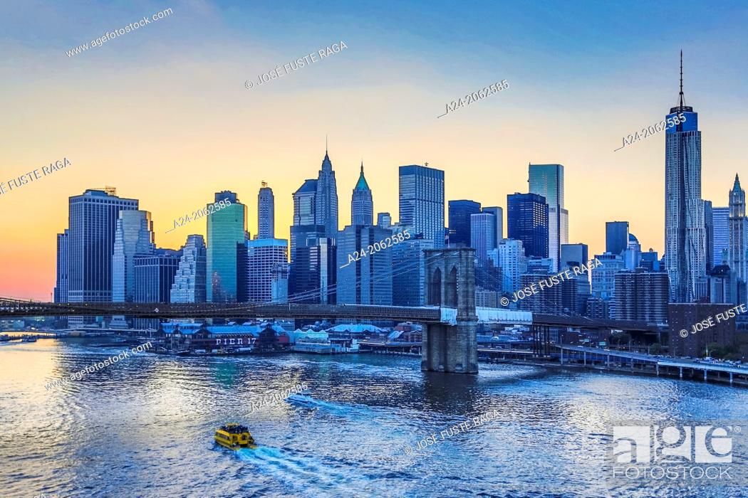 Stock Photo: USA , New York City, Downtown Skyline at sunset.