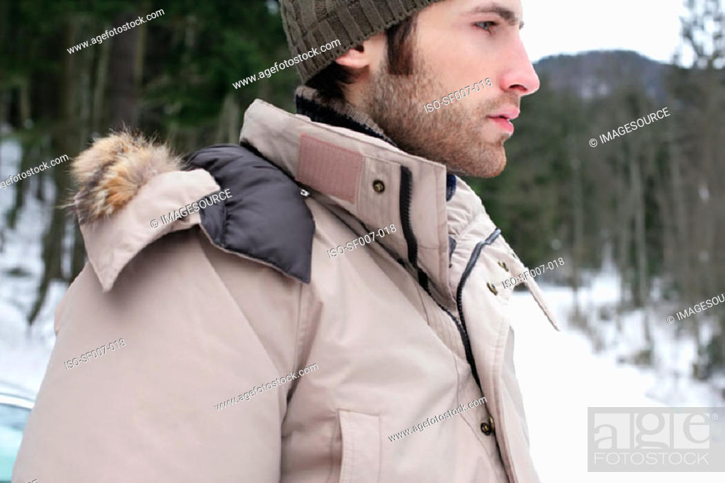 Stock Photo: Young man outside in the snow.