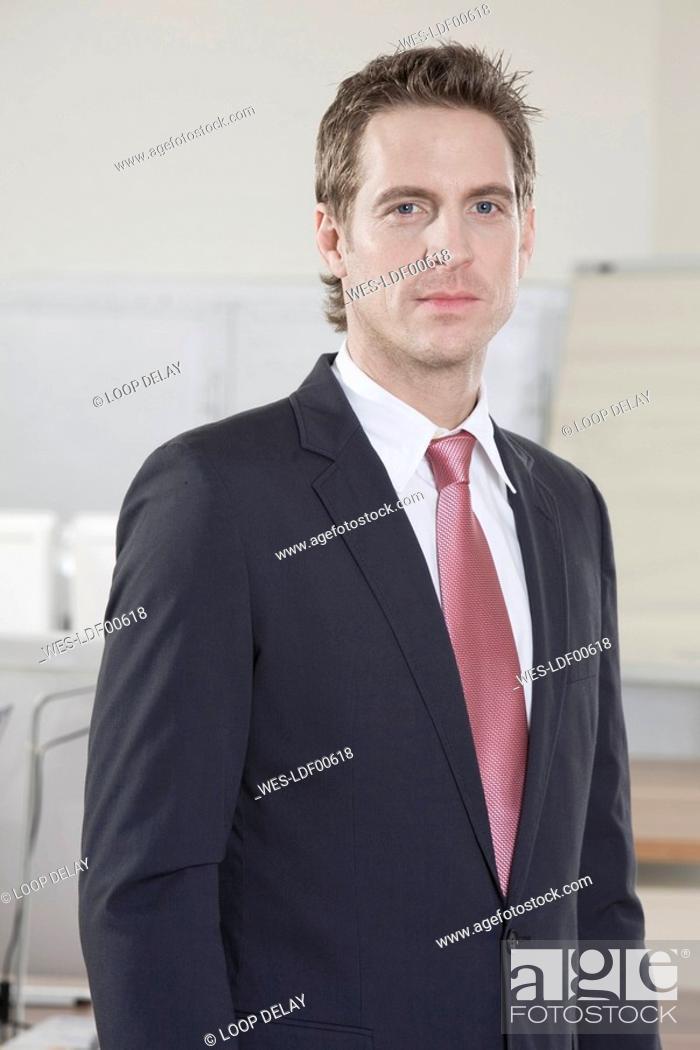 Stock Photo: Germany, Munich, business man, portrait, close-up.