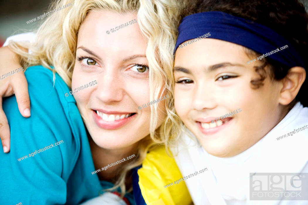 Stock Photo: Close-up of a mother and her daughter smiling.