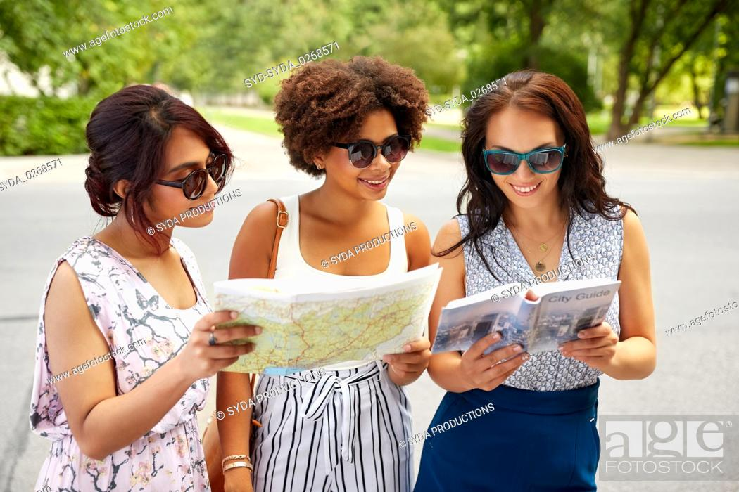 Photo de stock: happy women with city guide and map in summer.