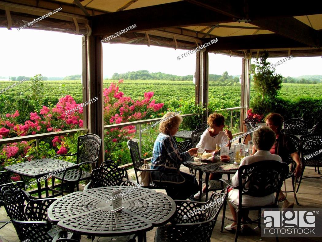 Stock Photo: Mattituck, NY, Long Island, New York, Macari Vineyards and Winery, wine tasting, porch.