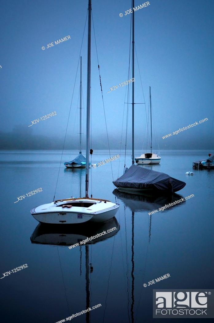 Stock Photo: Sailboats on fog shrouded Lake Harriet at dawn.
