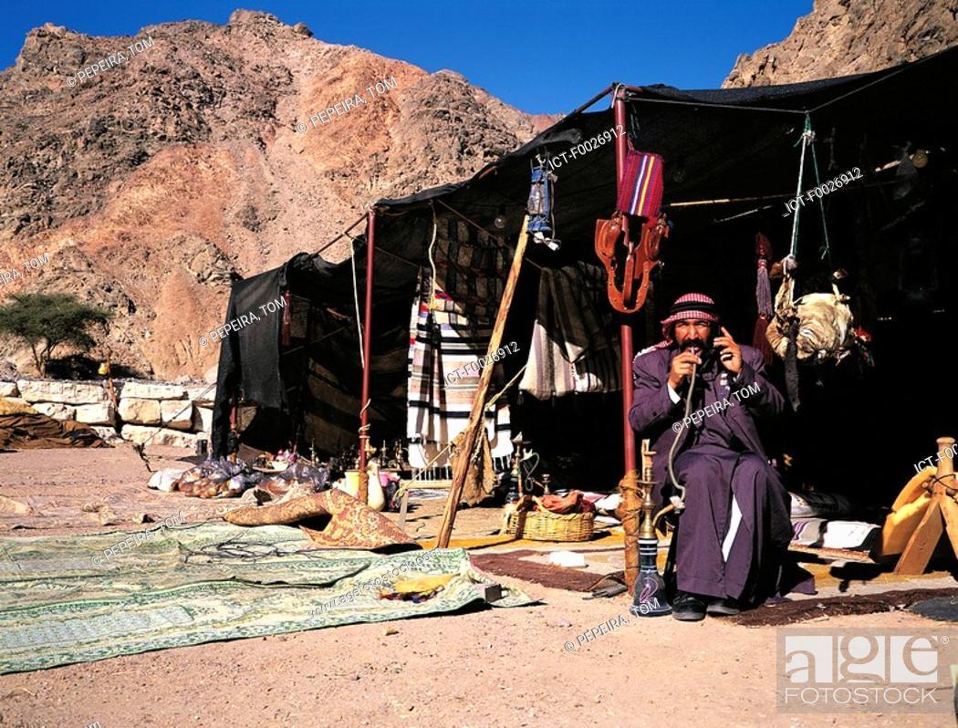 Stock Photo: Israel, near Eilat, Negev desert, man in his Bedouin tent.