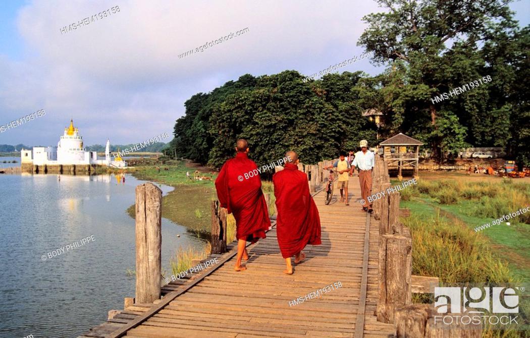 Stock Photo: Myanmar Burma, Mandalay Division, Amarapura old city, Buddhist monks on U Bein Bridge.