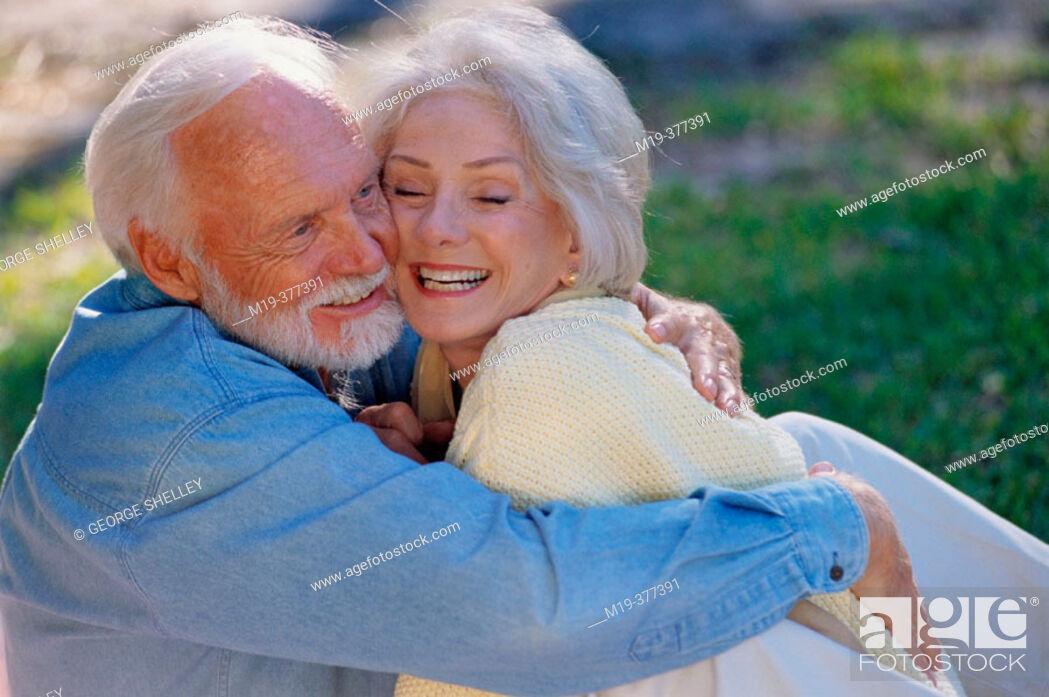 Stock Photo: Senior couple embracing.