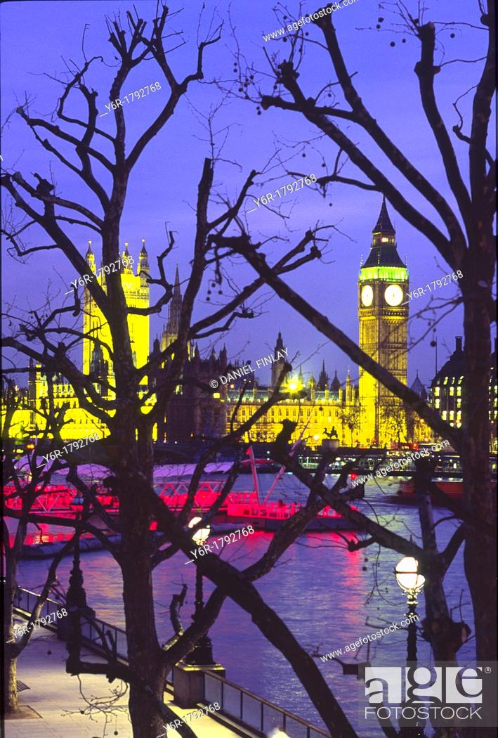 Stock Photo: View of an illuminated Big Ben and the Houses of Parliament across the River Thames at nightfall as seen from Hungerford Footbridge in London, England.