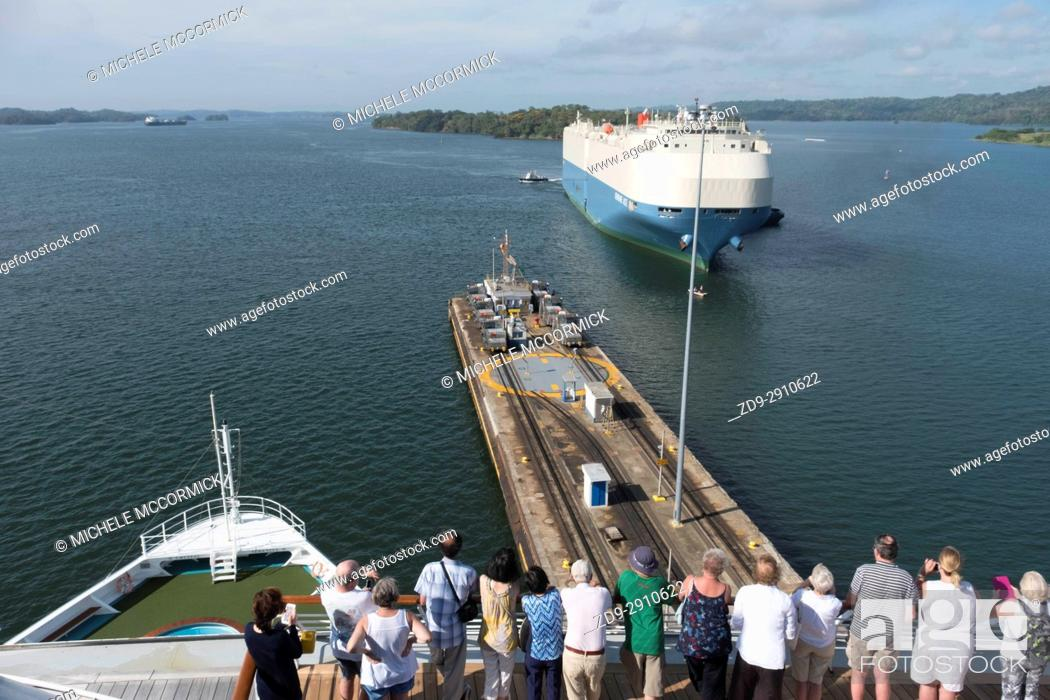 Stock Photo: Tourists watch as a ship approaches a lock in the Panama Canal.