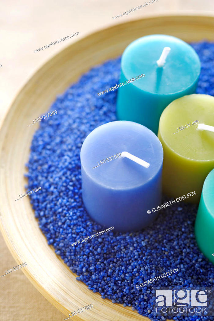 Stock Photo: Candles in blue sand.