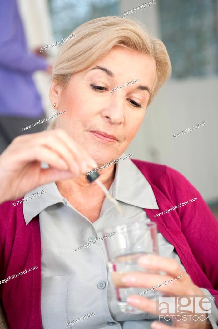 Stock Photo: Close-up of a woman taking medicine.