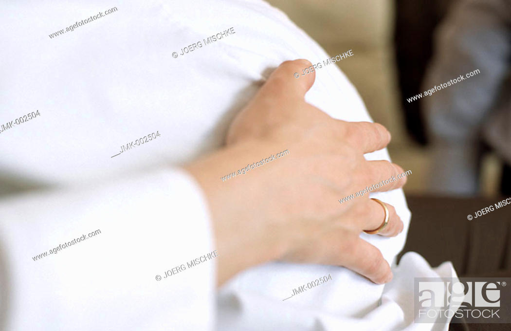 Stock Photo: A young pregnant woman, holding her belly.