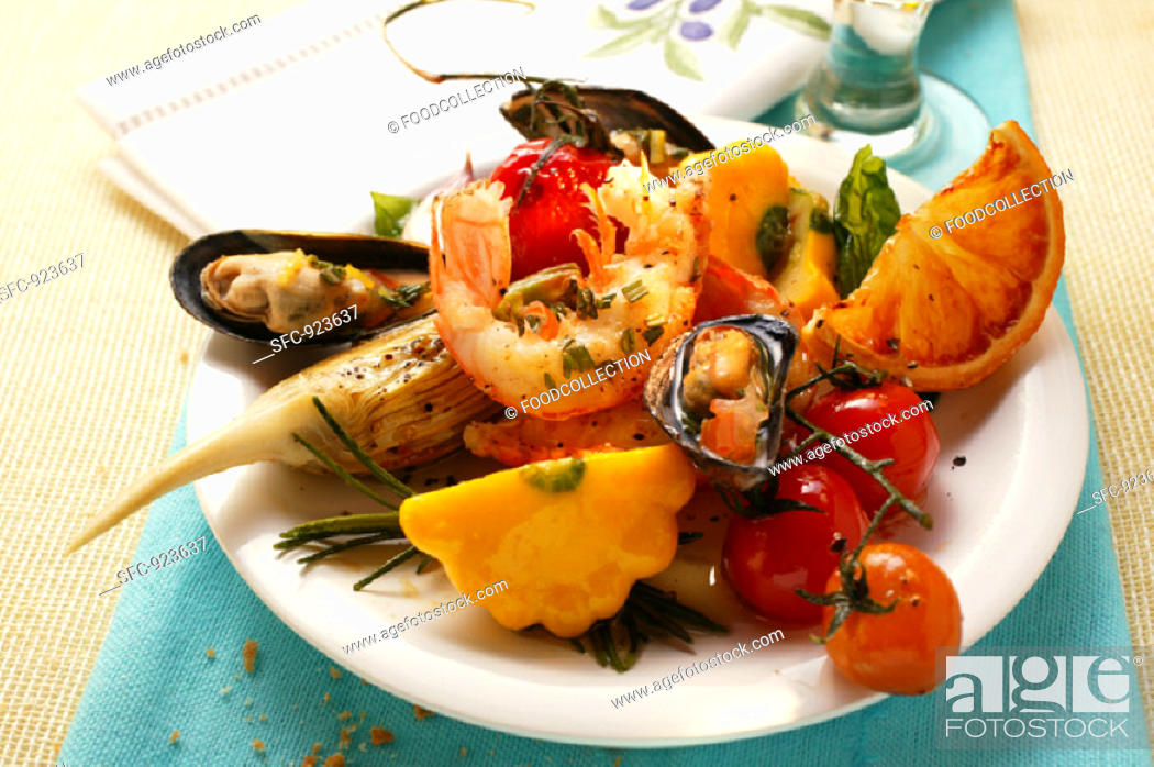 Stock Photo: Plate of Mediterranean appetisers (seafood, vegetables).