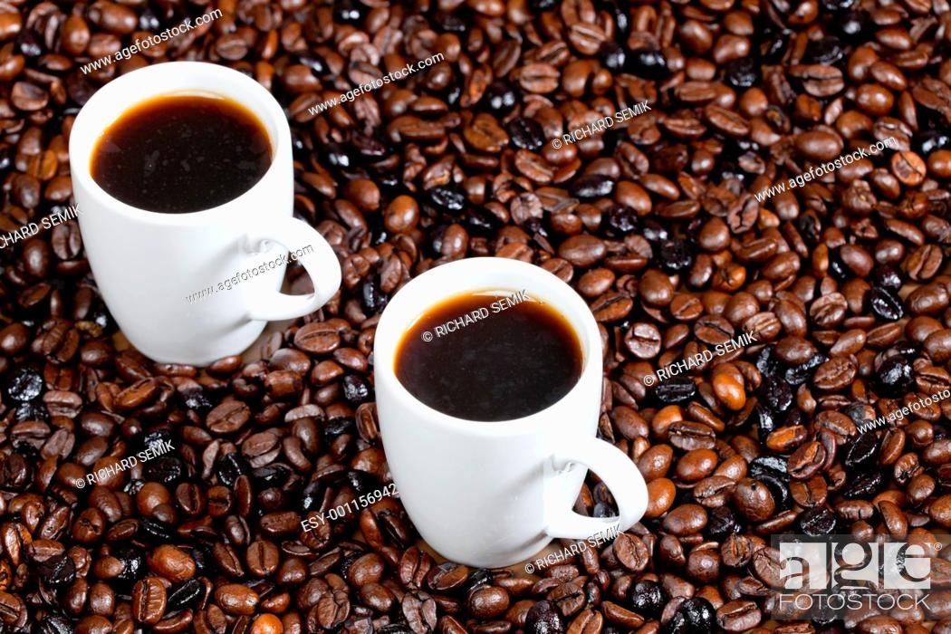 Stock Photo: still life of coffee cups and coffee beans.