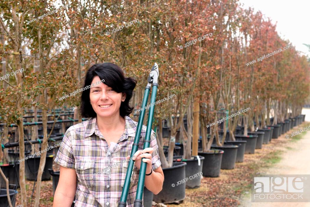 Stock Photo: woman working in a gardening center.