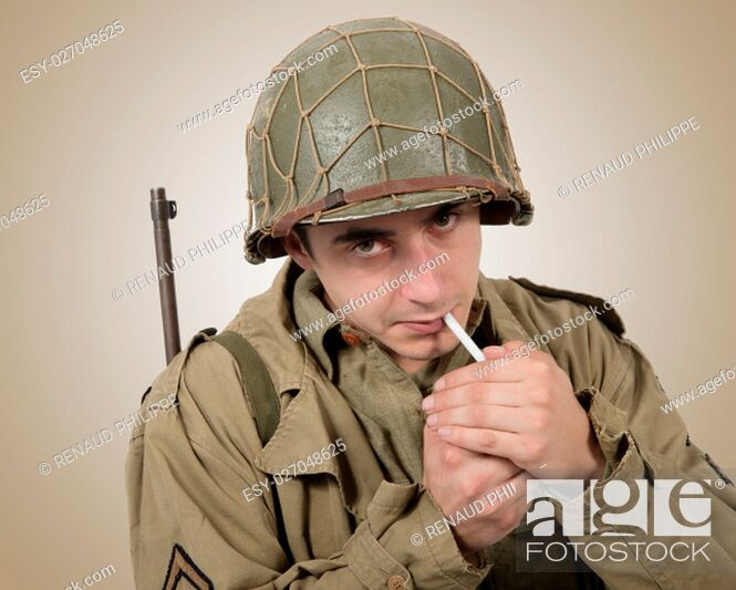 Stock Photo: young American soldier smoke a cigarette, world war two.