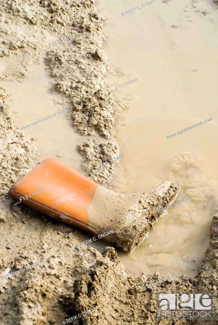 Stock Photo: Worker boot in construction area.