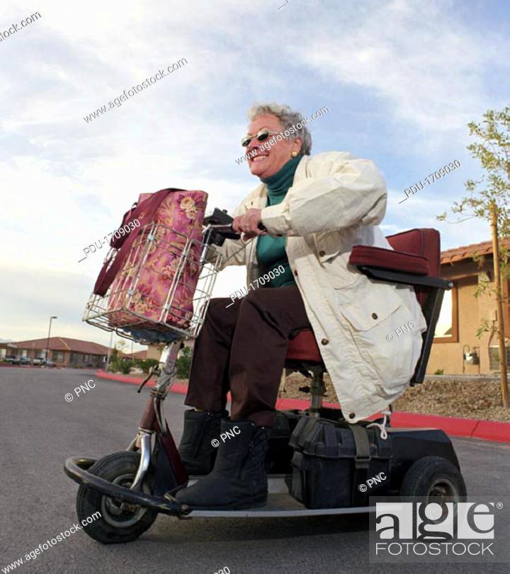 Stock Photo: Agressive Senior Woman Speeding.