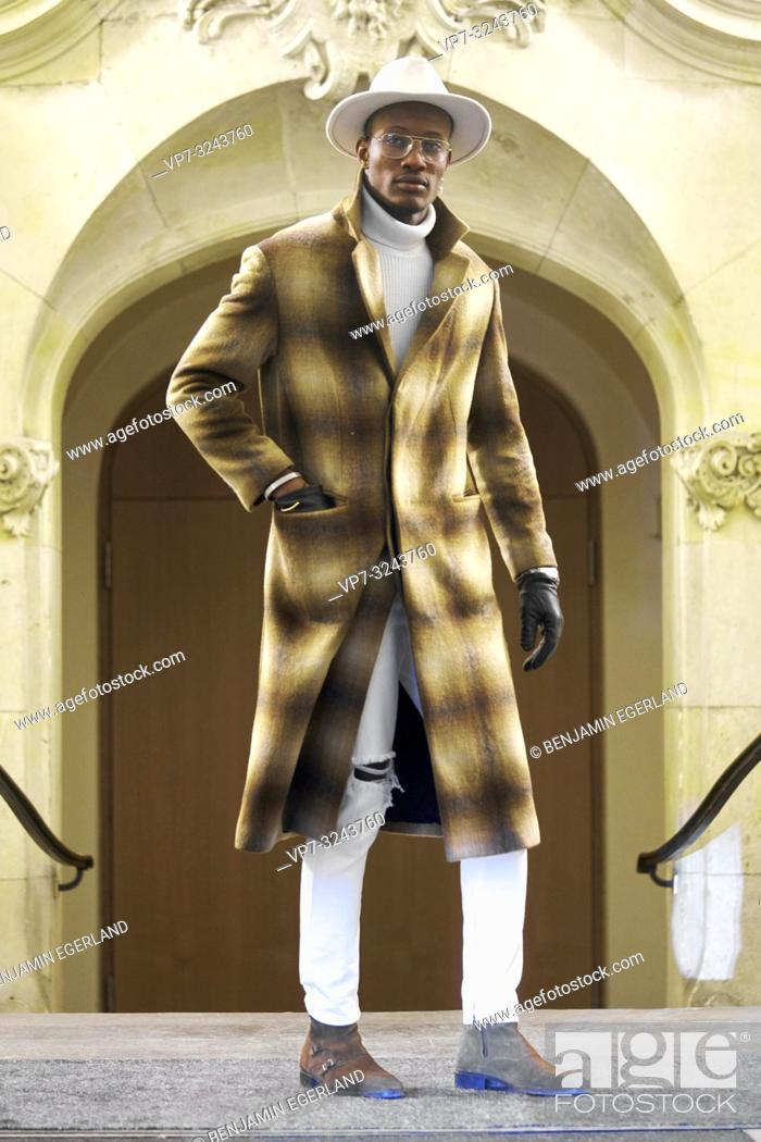 Stock Photo: stylish man wearing winter coat in city, full body shot, men's trend outfit, in Munich, Germany.