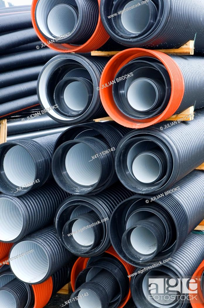 Stock Photo: Corrugated drainage pipes ready for a construction project in Norway.