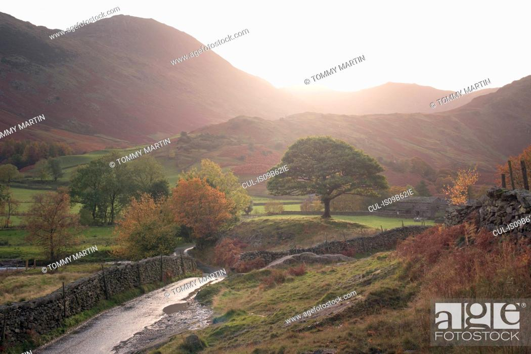 Stock Photo: Rural road through Little Langdale, The Lake District, UK.