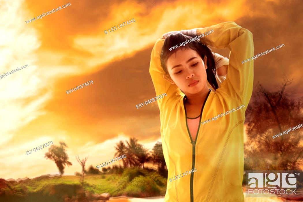Stock Photo: Young asian woman feel dehydration while training. Heat wave concept.