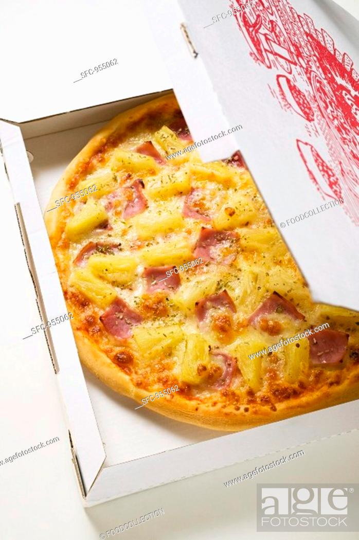 Stock Photo: Hawaiian pizza with ham and pineapple in pizza box.