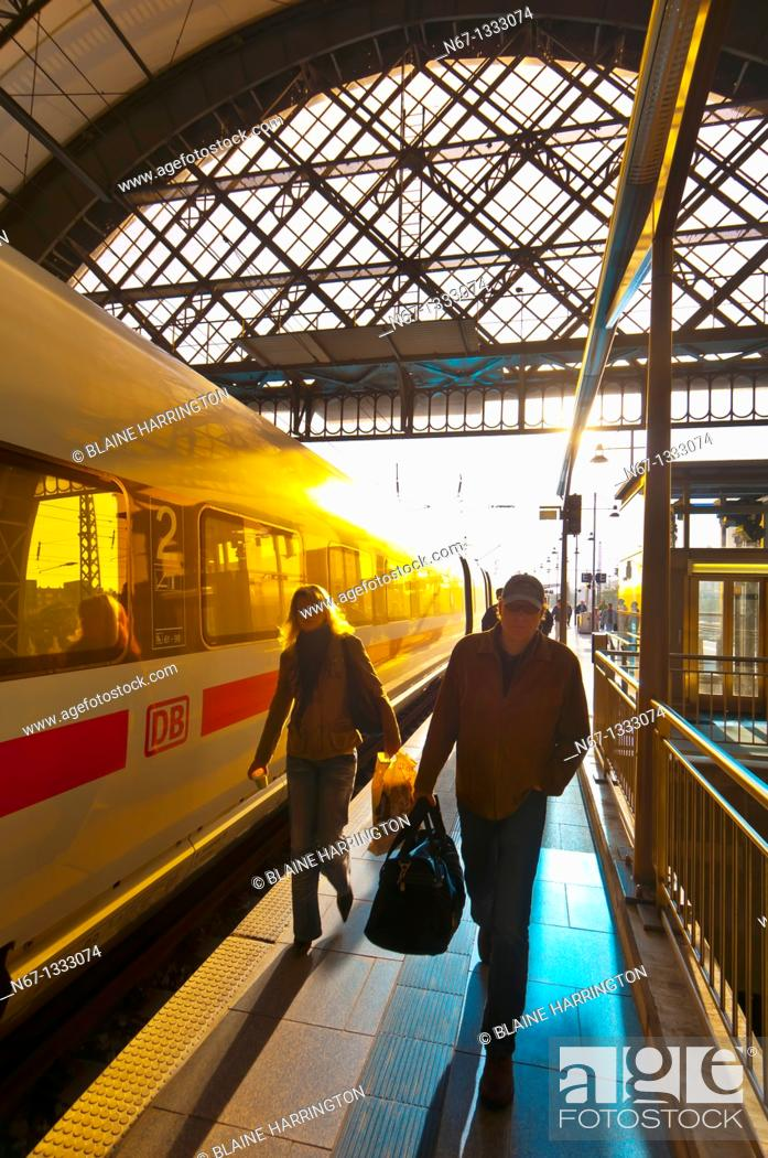 Stock Photo: Passengers arrive at the train station at Dresden after sunrise, Saxony, Germany.