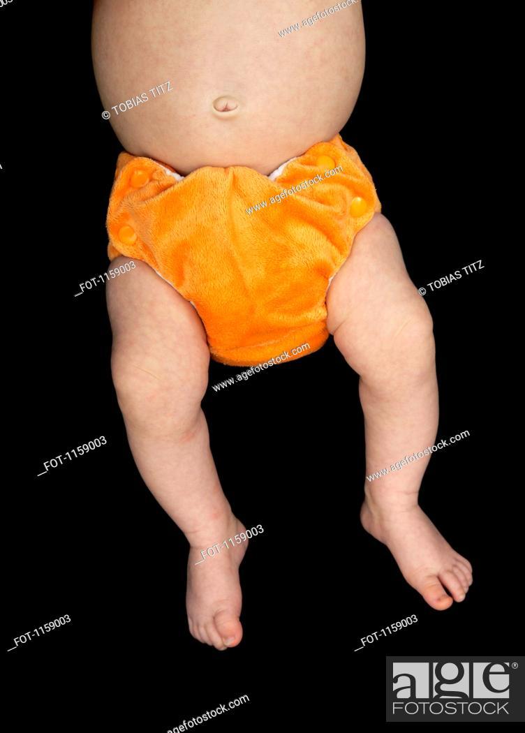Stock Photo: Baby in orange nappy.