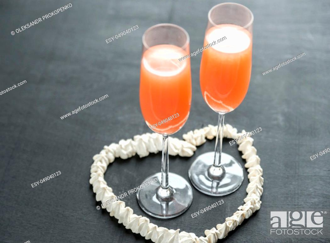 Stock Photo: Two bellini cocktails inside of meringue heart.