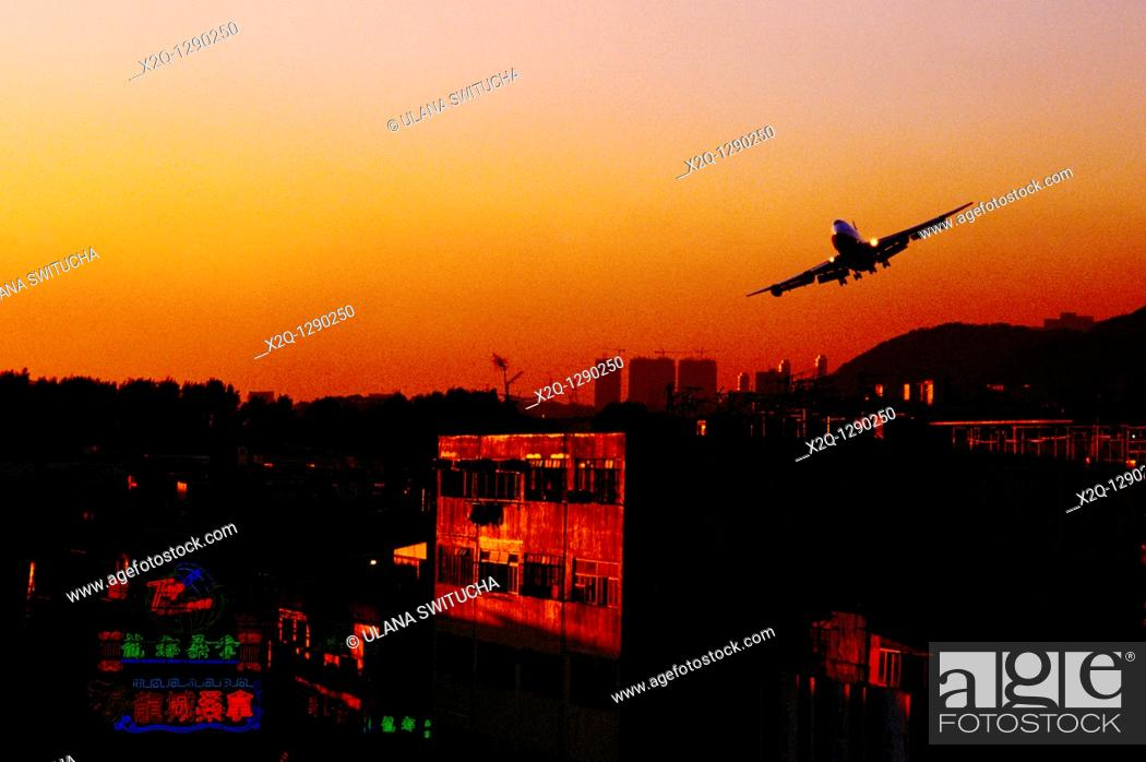 Stock Photo: Airplane landing at the old Kai Tak Airport in Hong Kong.
