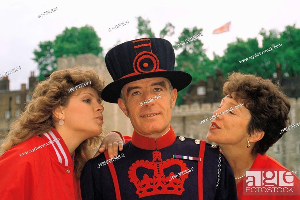Stock Photo: Tourists annoying beefeater in London, England.
