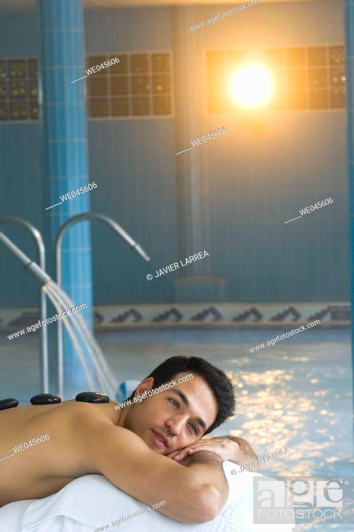 Stock Photo: Hot stone massage. Thalassotherapy Zelai, Zumaia, Gipuzkoa, Basque Country.