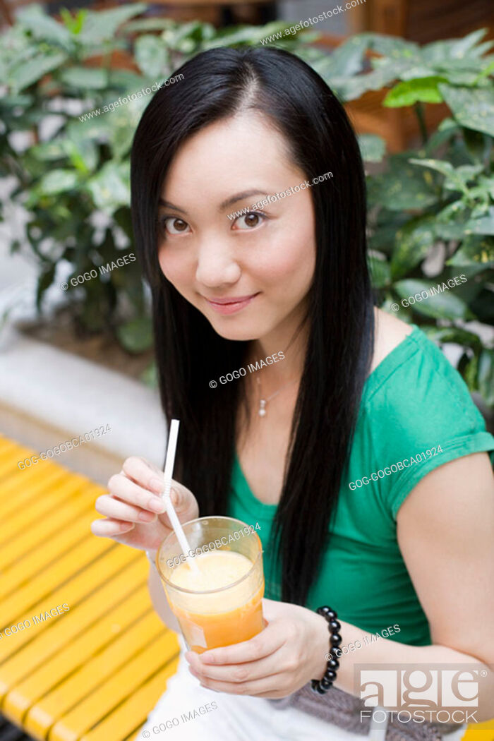Stock Photo: Young woman drinking juice.